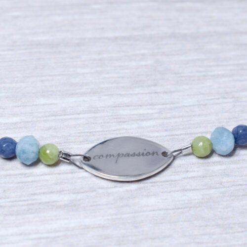aquamarine sterling silver daisy compassion bracelet