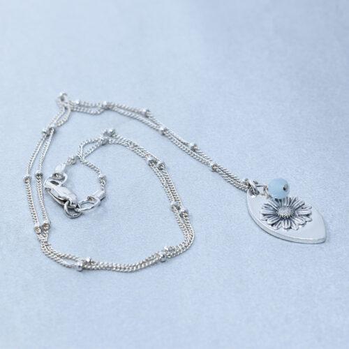 aquamarine silver daisy compassion necklace