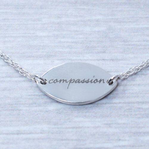 silver daisy compassion necklace